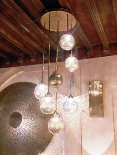 Moroccan ceiling pendant light fixture finely covered by hammered holes on brass. moroccan lighting