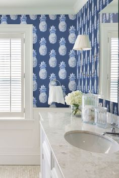 Blue pineapple wallpaper design called Aloha by Albany.