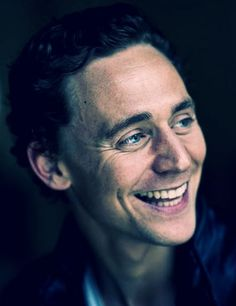 Tom Hiddleston seriously can you look at him smiling and not smile too?