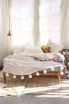 Interior design bedroom, wood bed & white blanket with pon pons - love it!