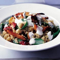 Spiced Bulghar, Chickpea & Squash Salad Recipe Salads with butternut squash, red pepper, harissa paste, oil, wheat, vegetable stock, garlic cloves, lemon, yogurt, garbanzo, spinach