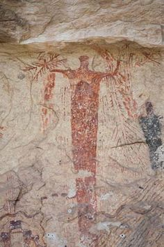 Rock painting of a shaman in Panther Cave, Texas dates from the Archaic period.