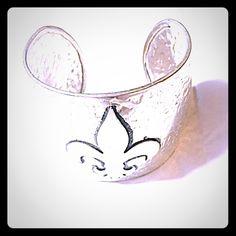 Fleur de lis Cuff Bracelet Stylish, hammered silver fleur de lis cuff bracelet. Nice, sturdy piece! Jewelry Bracelets