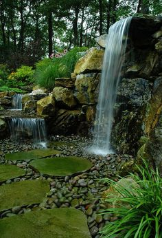 rotted retaining wall becomes and aquascape miracle project showcase how we went, decks, patio, ponds water features, pool designs, Bluestone stepping stone lead through the 7 natural waterfall and stream Project by Deck and Patio Company Huntington Station New York Read more