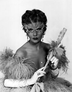 """1955. Ludmilla Tchérina in the costume she wears for the masked ball at the climax of Oh…Rosalinda! A caption on the back of the photo explains: Ludmilla Tcherina as Rosalinda in the new Michael Powell – Emeric Pressburger Technicolor CinemaScope production """"OH-ROSALINDA!!"""" Starring Michael Redgrave and Mel Ferrer, Dennis Price, Anthony Quayle, Anneliese Rothenberger, Oska …"""