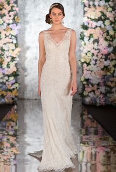 Brides: Martina Liana. Parisian silk chiffon gown with accent lace and hand-beading. Features of this sheath gown also include an open back, scalloped hem and court train.��More Details From Martina Liana