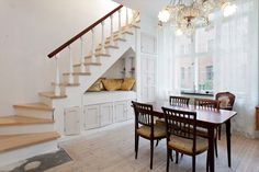 Diningroom with staircase that holds closet, storage space and a small alcove for small people to hang out in. (a tv-antenna is built into area under staircase)