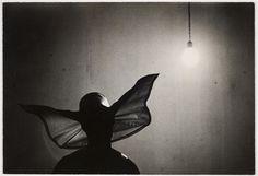 Marvin Koner - Sister on night rounds in orphanage; wearing cornette; nun; Havana, Cuba. 1953.