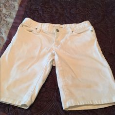 Michael Kors Bermuda shorts in white Perfect for spring and summer! These Michael Kors Bermuda style shorts are really cute on. They have silver hardware. They have one small stain, but it's not very noticeable. Michael Kors Shorts Bermudas