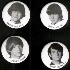 Looks like pins.  I don't remember black & white ones, but I remember the color ones.
