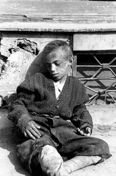 Warsaw, Poland, A poor, abandoned child sitting on the ground in the ghetto. The child did not survive. One of the photographs taken by the German photographer Willi George over the course of a single day in the summer of 1941. The photographs are unique in that they were not staged, but showed the ghetto as it truly was.