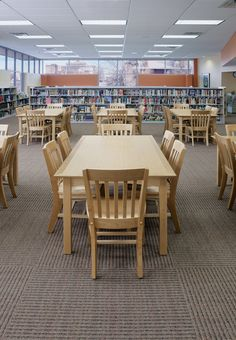 Kay-Twelve.com Add larger tables and chairs to your open spaces in the library for collaboration.
