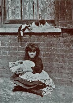 """Little is known of Horace Warner and nothing is known of his relationship to the nippers. Only 30 of these pictures survive, out of 240 he took in 1912 of the Spitalfields Nippers, East End London. They originally  accompanied the annual reports of the charitable Bedford Institute, Quaker St, Spitalfields as illustrations of poverty, """"but that is not the sum total of these beguiling photographs...spirited images of something more subtle and compelling, the elusive drama of childhood itself."""""""