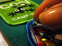 Sewing on Girl Scout Badges by Hand