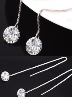 This is a set of 925 sterling silver set with cubic zirconia ball pull through dangle earrings.