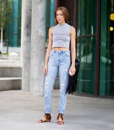 Distressed jeans and fringe accessories