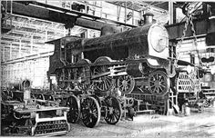 CALCUTTA PHOTOS: Jamalpur Workshop, established on 8th. February,1862, enjoys the distinction of being the oldest and the largest Locomotive workshop in India. The Picture shows activities of Erecting Shop during the hay days of Steam era.