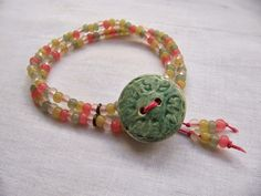 Use figure 8 to create a beaded loop. Tutorial Tuesday - Super Simple Button Bracelet