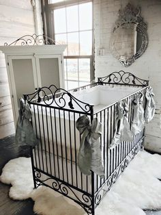 Casablanca iron baby bed by Bratt Decor.  Shown in pewter, with pewter bows.  Get it all at brattdecor.com