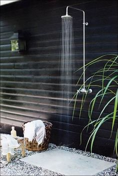 Ideas, Simple Outdoor Shower With Black Painted Wall Plus Concrete Flooring Decorated With Ornamental Pebble: Steps On Build Stylish Outdoor...