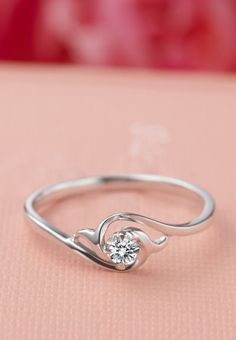 delicate, beautiful and unique    -there were several really nice, delicate ones on this web site (like this other one: http://www.jewelocean.com/solitaire-rings/3624-inexpensive-flower-shape-round-brilliant-solitaire-engagement-ring.html?defaultid=37965)