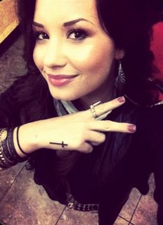 demi cross tattoo
