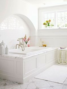Simple architectural details and an elegant materials palette create a timeless, restful space for bathing.