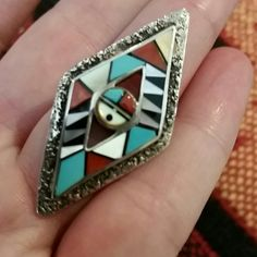 Beautiful Vintage Zuni Sterling  Inlaid Ring Beautiful design, large ring that will go up to your second knuckle. Ring is Size 5 but can easily be re-sized. Sterling Silver, MOP, Coral, Onyx, and Turquoise stones. Vintage Jewelry Rings