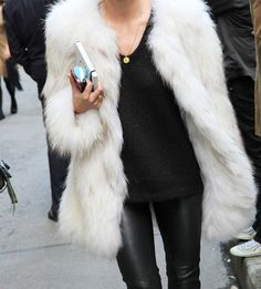 white fur coat, leather pants, black t shirt, street style, lady