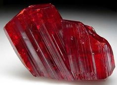 """Realgar, α-As4S4, is an arsenic sulfide mineral, also known as """"ruby sulphur"""" or """"ruby of arsenic"""". It is a soft, sectile mineral occurring in monoclinic crystals, or in granular, compact, or powdery form, often in association with the related mineral, orpiment"""