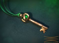 A unique Return to Oz inspired Orb Portal Key Pendant featuring ornate hand sculpted filigree in Raw Brass #ReturnToOz #WizardofOz #keys