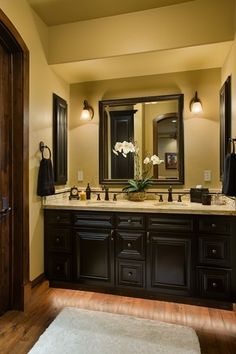 Dark cabinets (maybe), granite (not necessarily this color), oil rubbed bronze fixtures, framed mirror (needs to be larger)