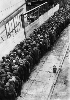Men waiting in an orderly line for an opportunity at a job during the Depression - 1930