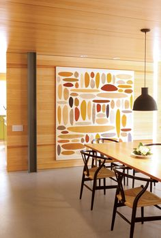 Modern dining room with pine walls and silicone lampshade
