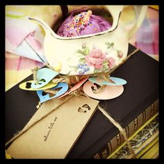 My BabyShowerGiftCreation.... Charming old kiddo books stacked&tied with sweet adornments, such as this CupcakeBakedInATeacup!