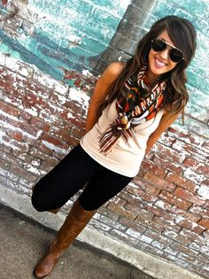 statement scarf, cute tank, leggings (I'd wear black skinny jeans instead... I don't agree with leggings as pants if the butt is not covered completely like with a long tunic top or dress... not flattering) and knee high boots.