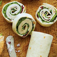 Turkey-and-Spinach Wraps with Cranberry-Walnut-Cream Cheese Spread | A pound of leftover roasted turkey is all you need to create this sampler of Thanksgiving favorites.