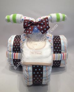 Tricycle Diaper Cake for Boy http://babyfavorsandgifts.com/tricycle-diaper-cake-for-boy-p-187.html