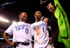 KANSAS CITY, MO - SEPTEMBER 15: Terrance Gore #0 and Jarrod Dyson #1 of the Kansas City Royals are interviewed after the Royals defeated the Chicago White Sox 4-3 to win the game at Kauffman Stadium on September 15, 2014 in Kansas City, Missouri. (Photo by Jamie Squire/Getty Images)