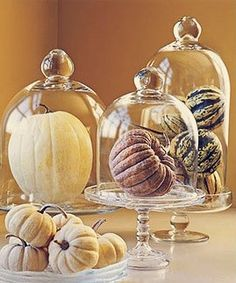 Adorable! Add some spray adhesive and glitter to pumpkins and gourds and display in an apothecary jar. (This could totally double as home decor after the big day!)