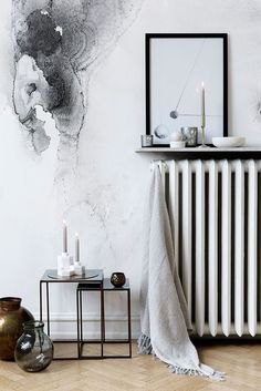 White interior floating shelf over radiator monocromatic room herringbone floor watercolor mural White interior floating shelf over radiator monocromatic room herringbone floor watercolor mural Decor, Interior Design, House Interior, Radiator Shelf, Radiators, Home, Apartment Design, Home Decor, Room