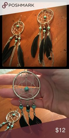 Dream catcher Earrings Silver dream catcher earrings with black feathers and teal, silver and black beading.  Not too heavy.  Gently pre-owned and in good condition. Small blemishes on some beads Jewelry Earrings