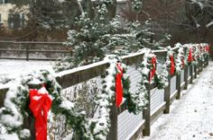 Fence decorated with bows and garland for Christmas
