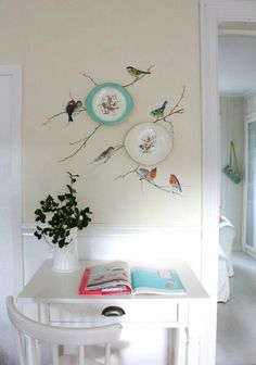 Bring the outdoors in... Pretty plates have been hung on a kitchen wall over branches-'n-birds wall decals or trompe l'oeil painting. <> (bird, decor, decorating, motif)