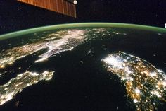North Korea in the Dark by Fragile Oasis   Light is not playing a trick on your eyes - in between the blazing night lights of China on the left and South Korea on the right - 25 million Earthlings of North Korea in the dark. This picture was taken by a human living and working on the International Space Station 30 January 2014. Credit: NASA