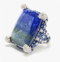 How about this natural tanzanite and sapphire ring to glam with at your next cocktail party ?