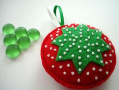 Felt green star Christmas tree ornament - Happy Holidays - Home Decoration - red green and white seed beads. $6.00, via Etsy.