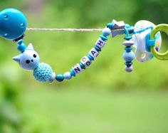 Juneberry Chique presents it's newest design of a teal and blue colored owl PACIFIER HOLDER. The pacifier clip can be personalized with baby's name and also makes a great baby shower gift. Never lose the pacifier again or drop it on the dirty ground!