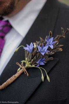 hatterscorsage -something blue for the groom