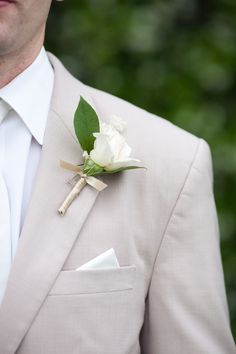 White rose Boutonniere for the ushers, fathers and brothers (10 in total)  Taupe fabric matches the bouquest - Alecia to provide